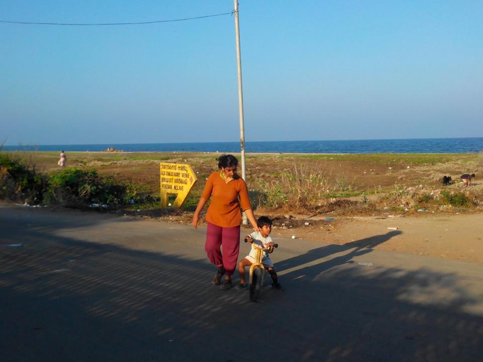 Ojas and her daughter Lyra pedalling for gender freedom by the beach