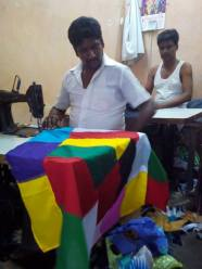 Chandrashekar Anna stitching the RGF flag